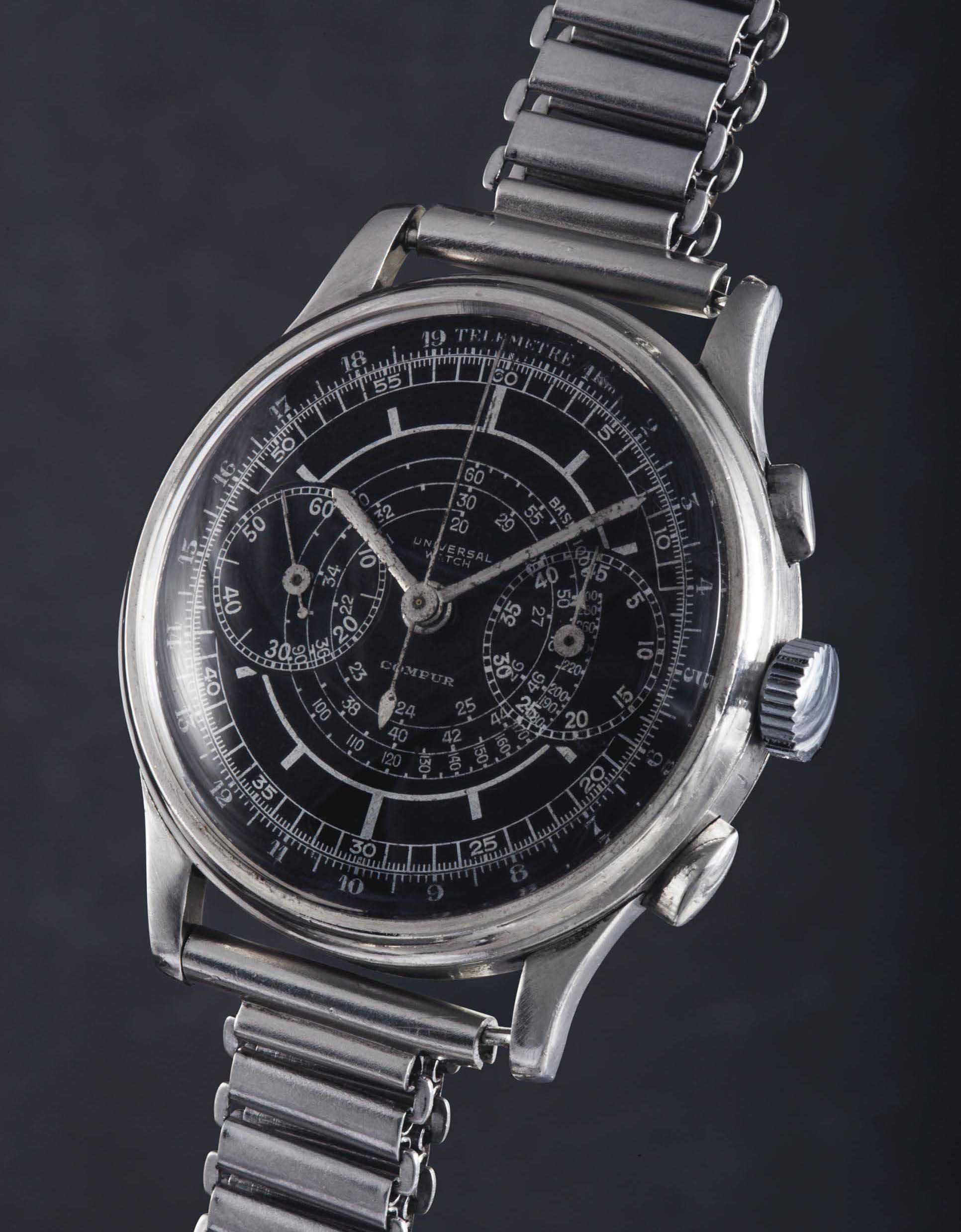 A 1st generation Compur with black sector dial by @Christies